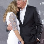 US actor Richard Gere, right, hugs his girlfriend Alejandra Silva during the premiere of the film: 'Time Out of Mind' in Madrid, Spain. Monday Nov. 23, 2015. (AP Photo/Abraham Caro Marin)