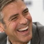 George Clooney laughs during a press conference for the film 'Up In The Air' during the Toronto International Film Festival in Toronto, Saturday, Sept. 12, 2009. (AP Photo/The Canadian Press, Sean Kilpatrick)