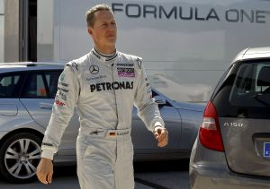epa02041969 German Formula One pilot Michael Schumacher of the Mercedes GP team walks during the pactice session that is being held at the Jerez race track in Jerez de la Frontera, southern Spain on 19 February 2010.  EPA/JULIO MUNOZ