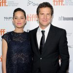 "French actress Marion Cotillard and companion director Guillaume Canet arrive at the premiere of ""Blood Ties"" on day 5 of the 2013 Toronto International Film Festival at the Roy Thomson Hall on Monday, Sept. 9, 2013, in Toronto. (Photo by Evan Agostini/Invision/AP)"